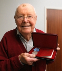 Tom proudly displays his Artic Convoy medal